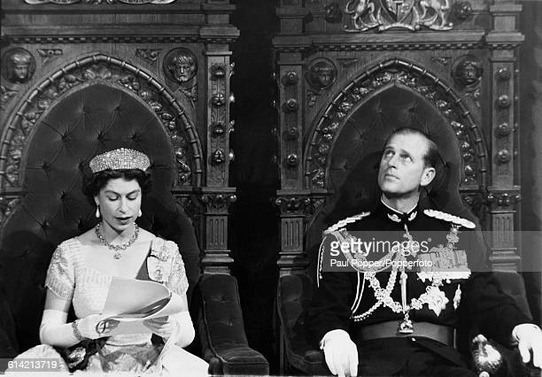 Prince Philip Duke of Edinburgh looks up to the ceiling as Queen Elizabeth II reads her speech to members of the Canadian Parliament during the 23rd...