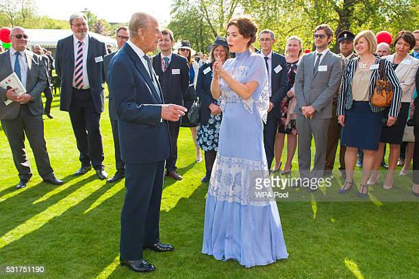 Prince Philip Duke of Edinburgh meets Anna Friel during the Duke of Edinburgh Award's 60th Anniversary Garden Party at Buckingham Palace on May 16...