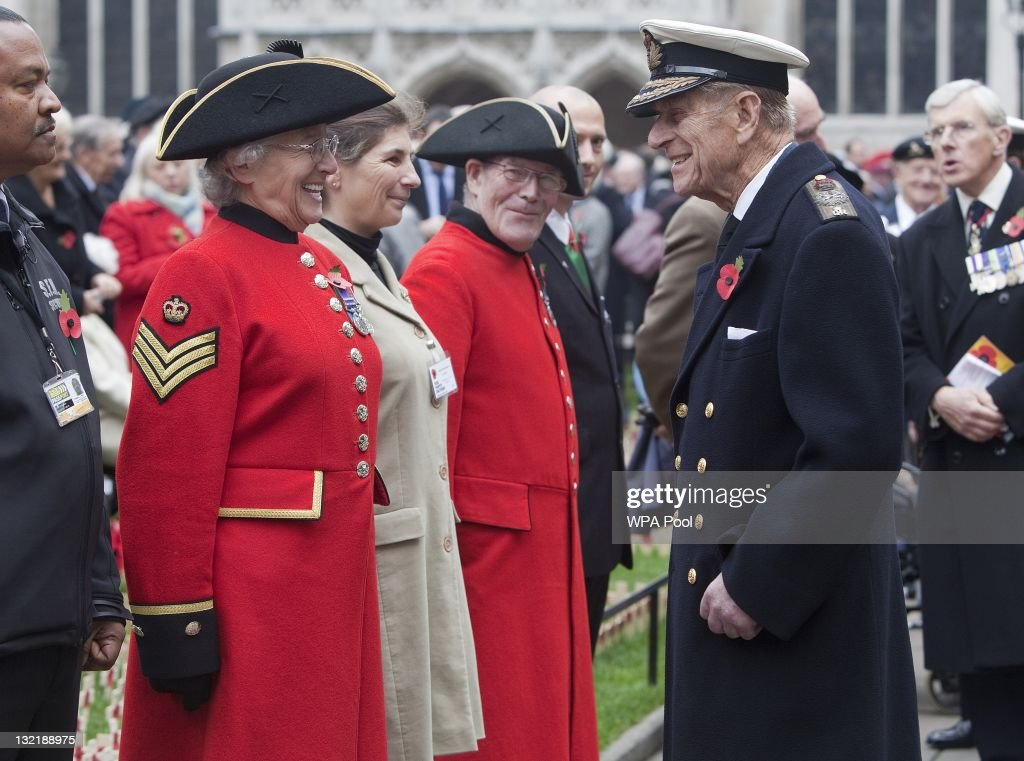 Prince Philip, Duke of Edinburgh meets female Chelsea pensioner Majorie Cole during a visit to the Field of Remembrance at Westminster Abbey on November 10, 2011 in London, England.