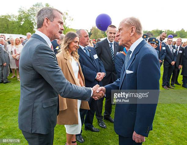 Prince Philip Duke of Edinburgh meets former astronaut Chris Hadfield during the Duke of Edinburgh Award's 60th Anniversary Garden Party at...