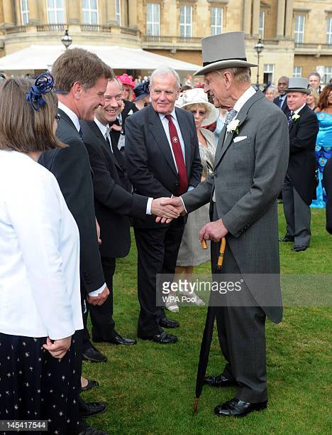 Prince Philip Duke of Edinburgh meets guests during a garden party at Buckingham Palace on May 29 2012 in London England