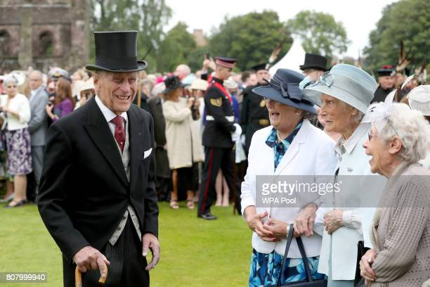 Prince Philip Duke of Edinburgh meets members of the Glasgow Wrens Association during the annual garden party at the Palace of Holyroodhouse on July...