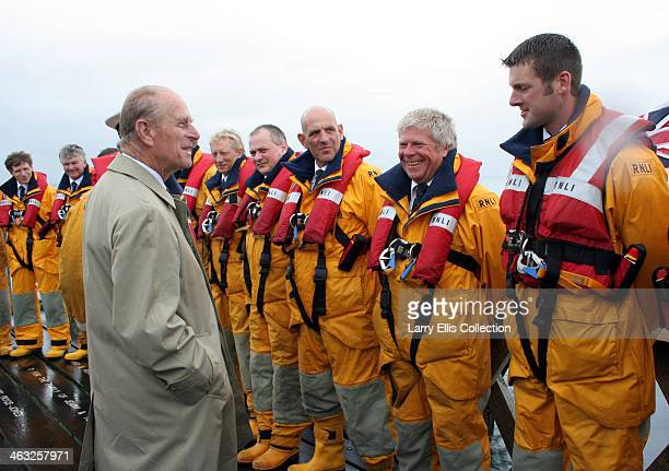 Prince Philip, Duke of Edinburgh meets members of the RNLI during Cowes Week at Yarmouth, on the Isle of Wight, UK, August 2008. Among the men is...