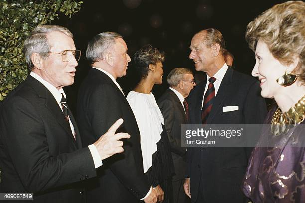 Prince Philip Duke of Edinburgh meets singer and actor Frank Sinatra during a visit to the 20th Century Fox studios in Hollywood California 27th...
