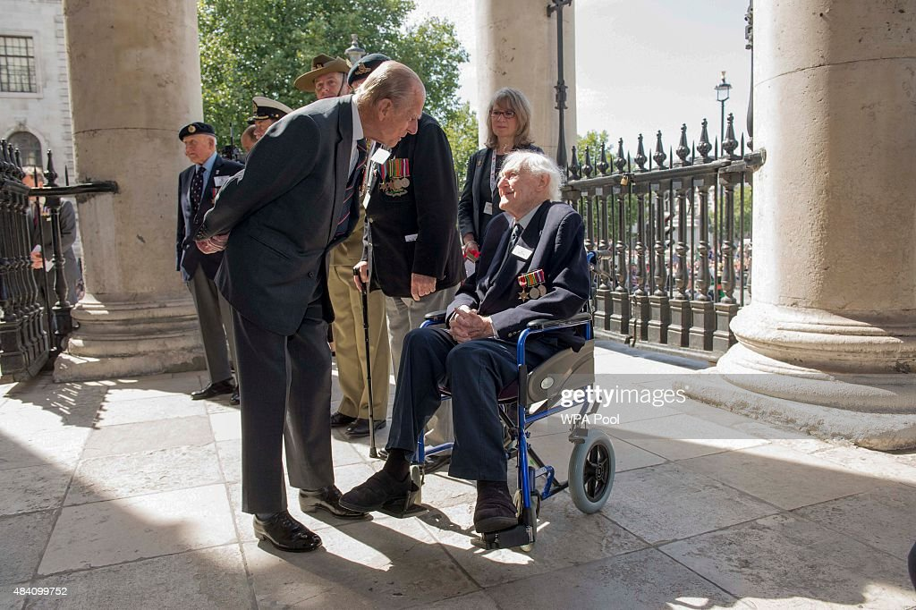 Prince Philip, Duke of Edinburgh meets veteran John Dean who served on the same ship as the duke during the 70th Anniversary commemorations of VJ Day (Victory over Japan) at St Martin-in-the-Fields Church on August 15, 2015 in London, England. The event marks the 70thanniversary of the surrender of Japanese Forces, bringing about the end of World War II. Queen Elizabeth II and Prince Philip, Duke of Edinburgh will join British Prime Minister David Cameron and former prisoners of war during services throughout the day as tributes are made to the the estimated 71,244 British and Commonwealth casualties of the Far East conflict. Japan formally surrendered on September 2, 1945 at a ceremony in Tokyo Bay on USS Missouri.