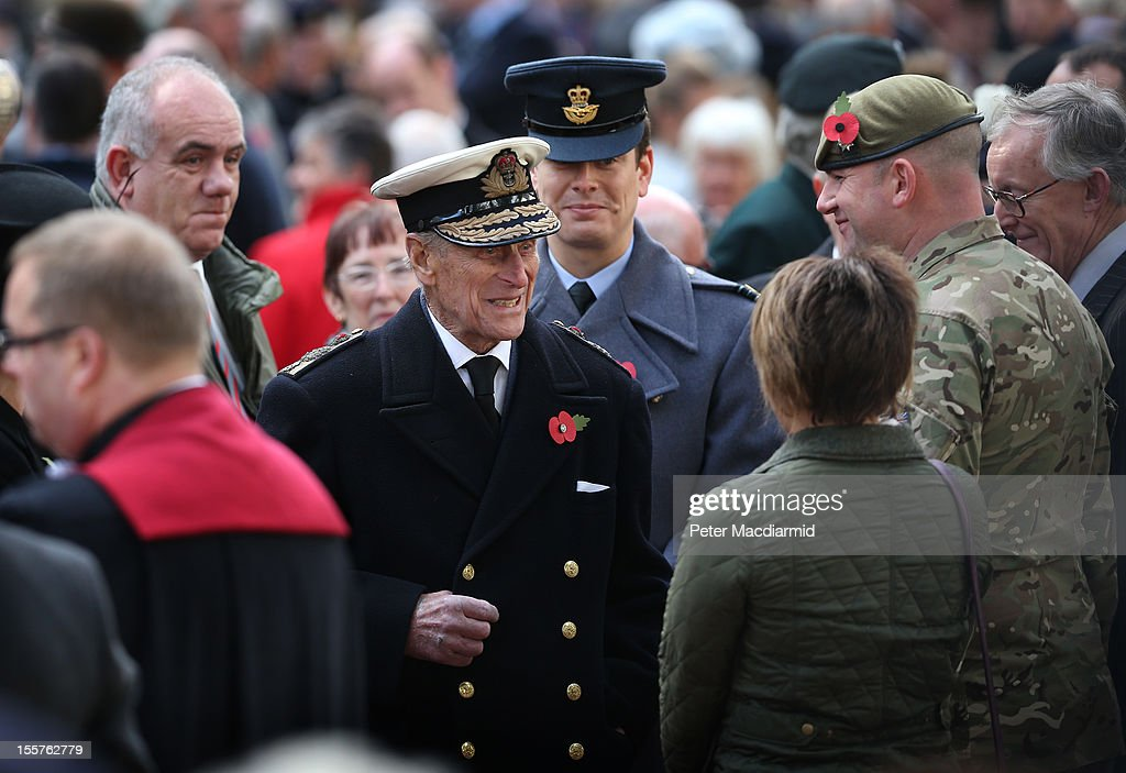 Prince Philip, Duke of Edinburgh, (C) meets with veterans and serving soldiers as he opens the Royal British Legion's Field of Remembrance at Westminster Abbey on November 8, 2012 in London, England. Hundreds of small crosses bearing a poppy have been planted in a Field of Remembrance in a tribute to British servicemen and women who have lost their lives in conflict.
