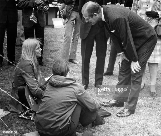 Prince Philip Duke of Edinburgh North West visits The Duke stoops to chat to guitar playing Ruth Caulfield aged 17 of Arley Close Chester Circa May...