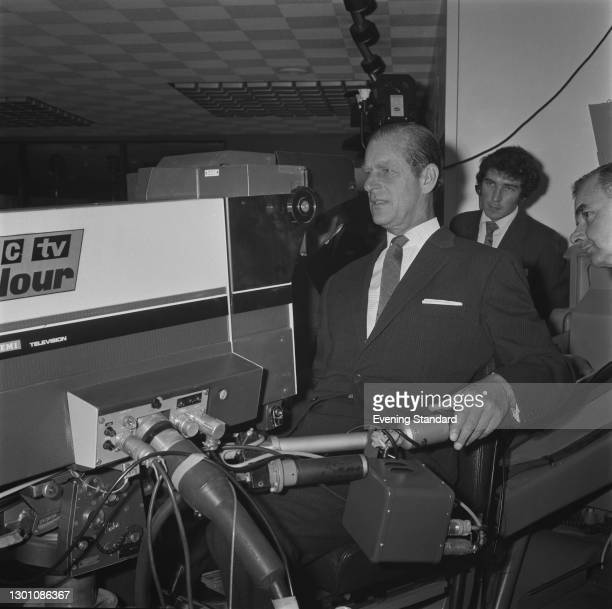 Prince Philip, Duke of Edinburgh operates a television camera at the BBC Television Centre in London on its 50th anniversary, UK, 24th July 1973.