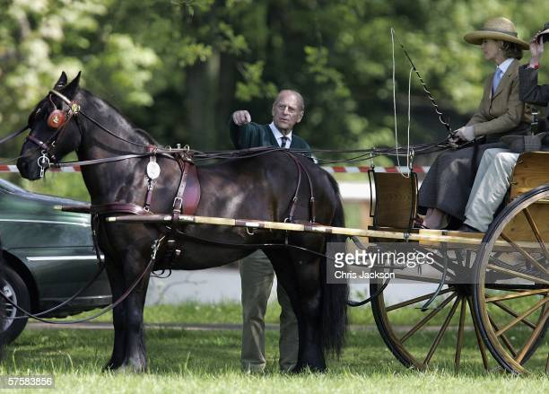 Prince Philip Duke of Edinburgh points over Lady Penny Brabourne's horse before it competes in the Land Rover International Driving Grand Prix on May...