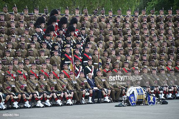 Prince Philip Duke of Edinburgh poses for a photo with soldiers of the 4th Battalion The Royal Regiment of Scotland on June 12 2014 in Fallingbostel...