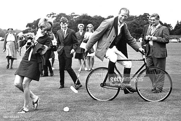 Prince Philip, Duke of Edinburgh practicing his bicycle polo technique, Windsor Great Park, Berkshire, 1964.