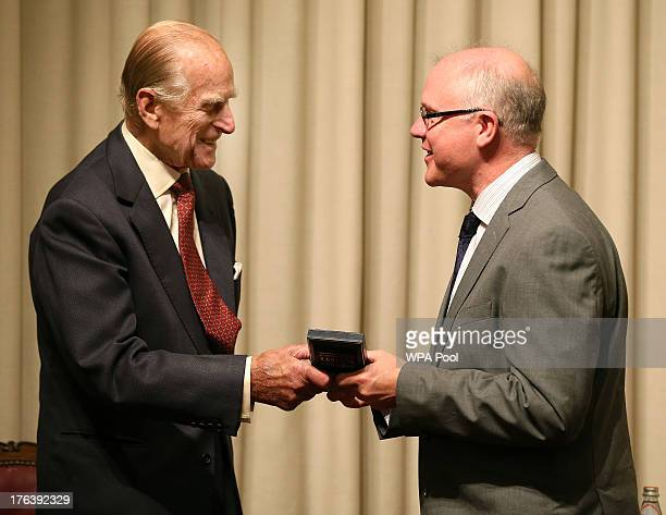 Prince Philip Duke of Edinburgh presents Professor Michael Ferguson with a Royal Medal during a medal presentation event at the Royal Society of...