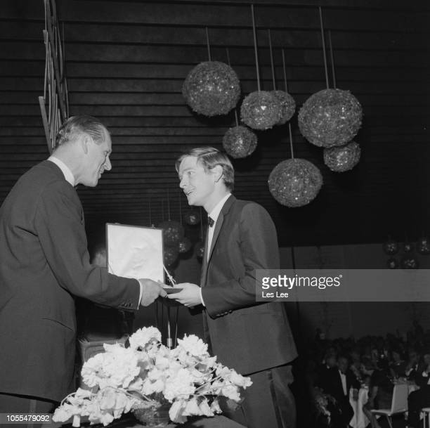 Prince Philip Duke of Edinburgh presents the Most Promising Newcomer award to English actor Tom Courtenay at the 16th British Academy Film Awards in...