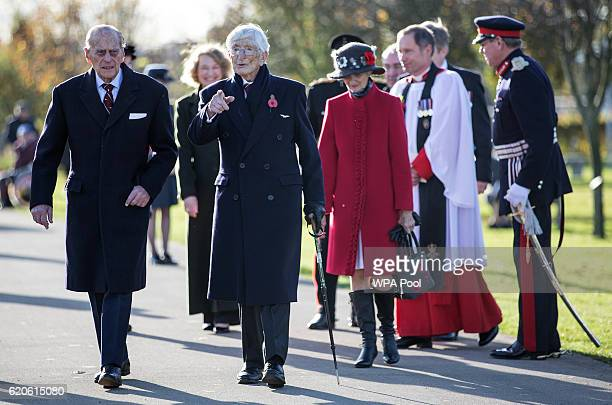 Prince Philip Duke of Edinburgh President of the Guinea Pig Club walks with Dr 'Sandy' Saunders a Surviving 'Guinea pig club' member before before...