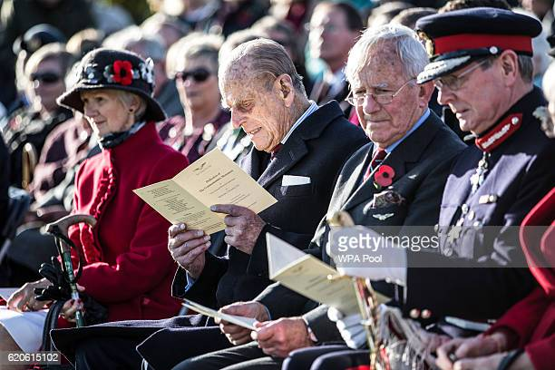 Prince Philip Duke of Edinburgh President the Guinea Pig Club sits with surviving members before he unveils the new memorial to those airmen saved...