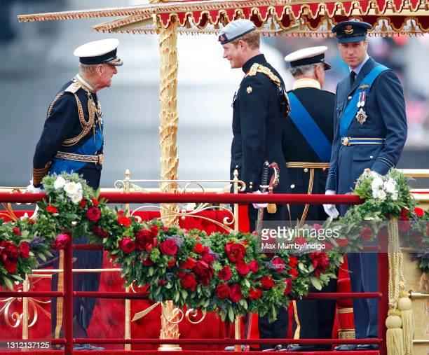 Prince Philip, Duke of Edinburgh, Prince Harry and Prince William, Duke of Cambridge onboard the Royal Barge 'Spirit of Chartwell' during the Diamond...