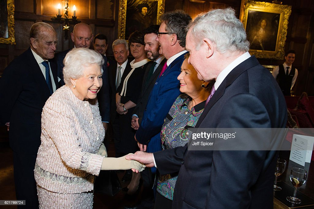 Prince Philip, Duke of Edinburgh (L) Queen Elizabeth II (middle) and Martin McGuinness (R) attend a Co-Operation Ireland Reception at Crosby Hall on November 8, 2016 in London, England. During the reception The Queen unveiled a portrait of herself by artist Colin Davidson