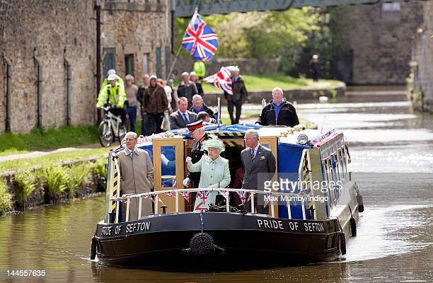 Prince Philip, Duke of Edinburgh, Queen Elizabeth II and Prince Charles, Prince of Wales travel down the Leeds and Liverpool Canal on the 'Pride of...