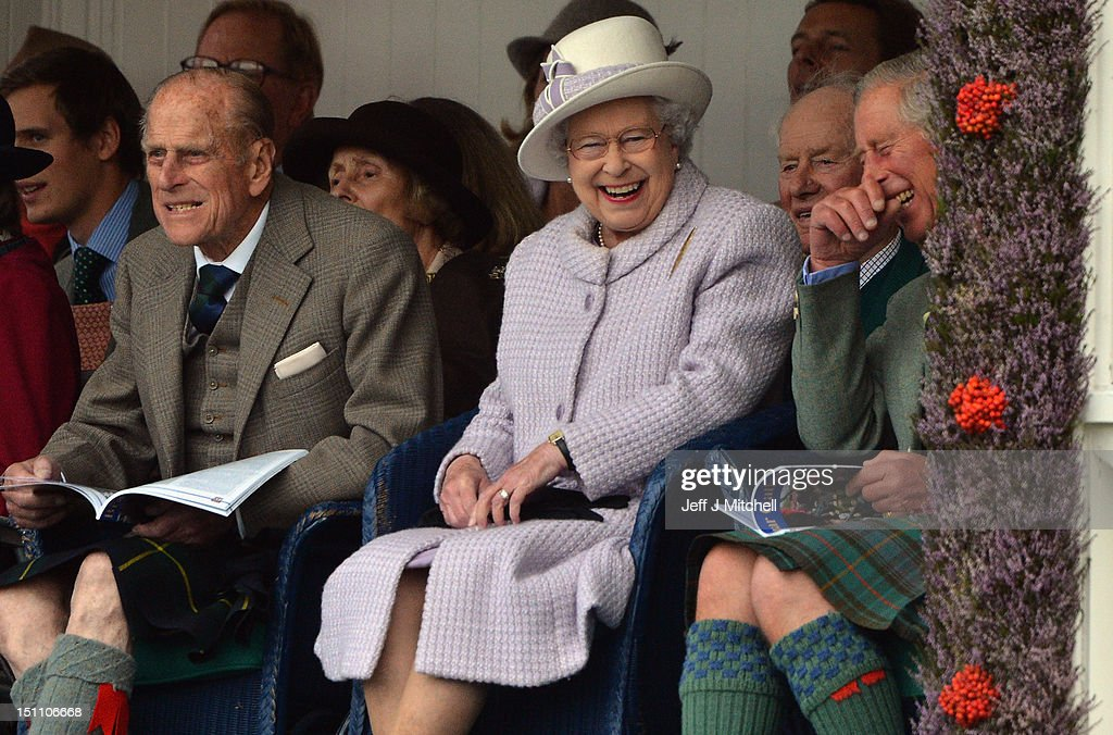Prince Philip, Duke of Edinburgh, Queen Elizabeth II and Prince Charles attend the Braemar Highland Games at The Princess Royal and Duke of Fife Memorial Park on September 1, 2012 in Braemar, Scotland. The Braemar Gathering is the most famous of the Highland Games and is known worldwide. Each year thousands of visitors descend on this small Scottish village on the first Saturday in September to watch one of the more colorful Scottish traditions. The Gathering has a long history and in its modern form it stretches back nearly 200 years.