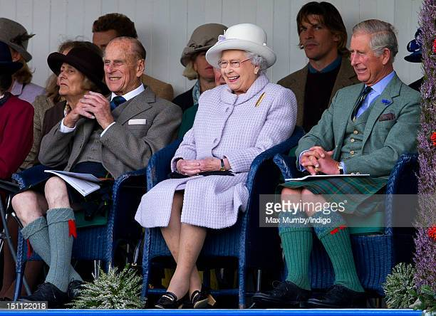 Prince Philip Duke of Edinburgh Queen Elizabeth II and Prince Charles Prince of Wales attend the 2012 Braemar Highland Gathering at The Princess...