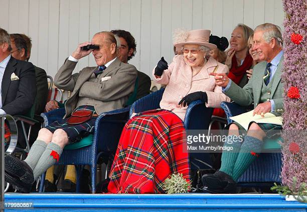 Prince Philip, Duke of Edinburgh, Queen Elizabeth II and Prince Charles, Prince of Wales attend the annual Braemar Highland Games at The Princess...