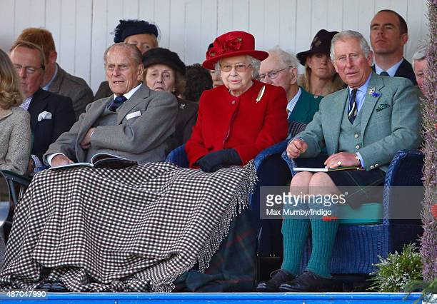 Prince Philip Duke of Edinburgh Queen Elizabeth II and Prince Charles Prince of Wales attend the Braemar Gathering at The Princess Royal and Duke of...