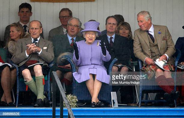 Prince Philip Duke of Edinburgh Queen Elizabeth II and Prince Charles Prince of Wales attend the 2016 Braemar Highland Gathering at The Princess...