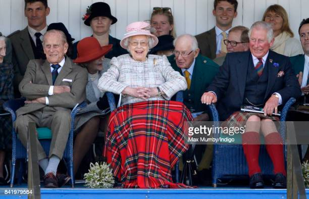 Prince Philip Duke of Edinburgh Queen Elizabeth II and Prince Charles Prince of Wales attend the 2017 Braemar Gathering at The Princess Royal and...