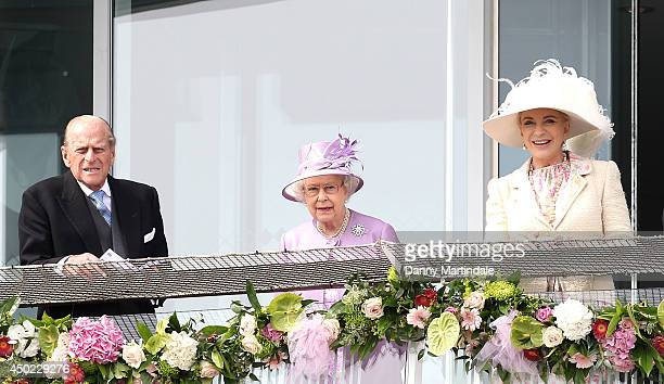 Prince Philip; Duke of Edinburgh, Queen Elizabeth II and Princess Michael of Kent watch the racing on Derby day at the Investec Derby Festival at...