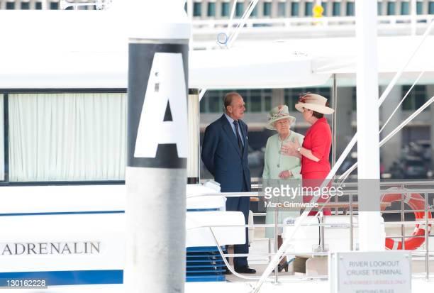 Prince Philip Duke of Edinburgh Queen Elizabeth II and Queensland Premier Anna Bligh prepare for a river cruise on October 24 2011 in Brisbane...
