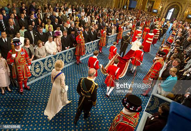 Prince Philip Duke of Edinburgh Queen Elizabeth II are followed by Prince Charles Prince of Wales and Camilla Duchess of Cornwall while arriving for...