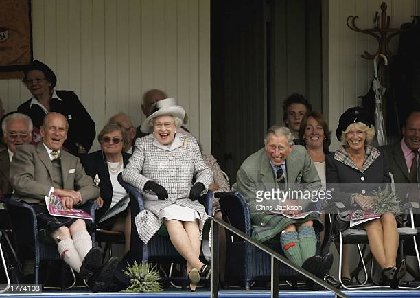 Prince Philip Duke of Edinburgh Queen Elizabeth II Prince Charles The Prince of Wales and Camilla Duchess of Cornwall break into laughter as they...