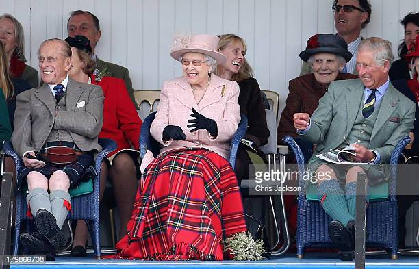 Prince Philip Duke of Edinburgh Queen Ellizabeth II and Prince Charles Prince of Wales laugh as they watch the sack race during the annual Braemer...