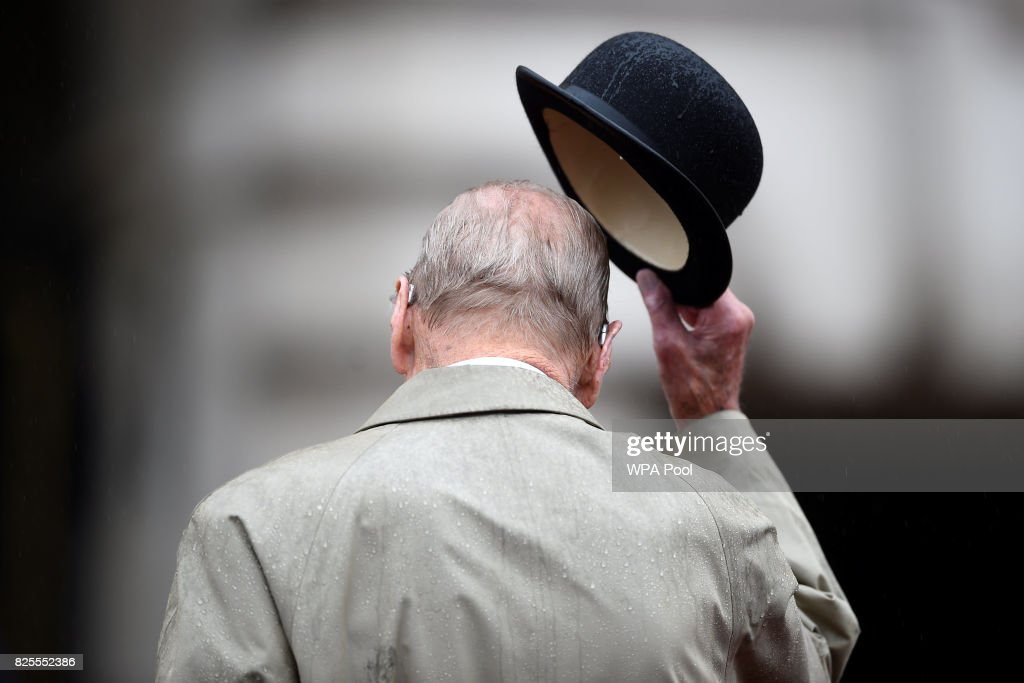 Prince Philip, Duke of Edinburgh raises his hat in his role as Captain General, Royal Marines, makes his final individual public engagement as he attends a parade to mark the finale of the 1664 Global Challenge, on the Buckingham Palace Forecourt on August 2, 2017 in London, England.