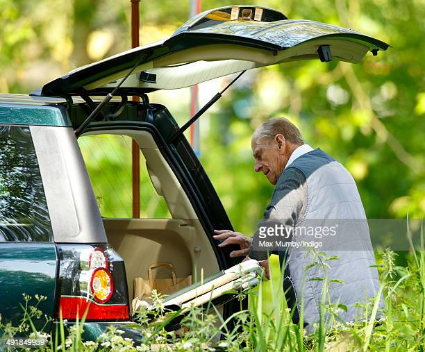 Prince Philip, Duke of Edinburgh removes a deckchair from the boot of his Land Rover Freelander car as he attends day 4 of the Royal Windsor Horse...