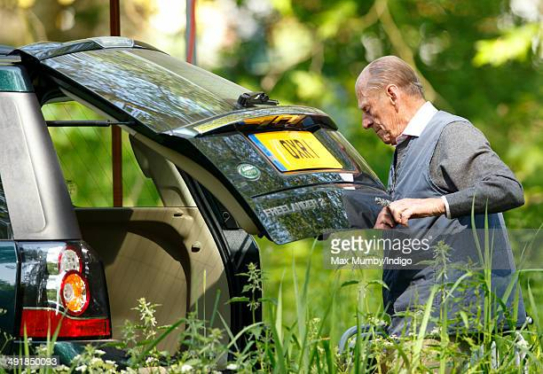 Prince Philip Duke of Edinburgh removes a deckchair from the boot of his Land Rover Freelander car as he attends day 4 of the Royal Windsor Horse...