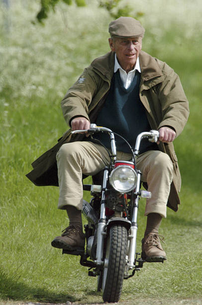 HRH Prince Philip Duke Of Edinburgh Rides Mini Motorcycle Around The Royal Windsor Horse Show