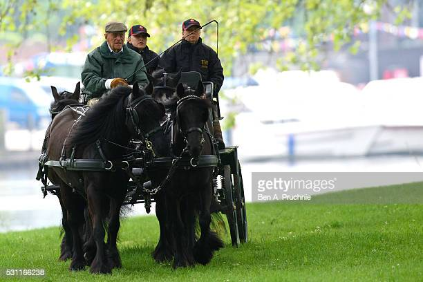Prince Philip Duke of Edinburgh rides on a horse and carriage during the Royal Windsor Horse Show on May 13 2016 in Windsor England