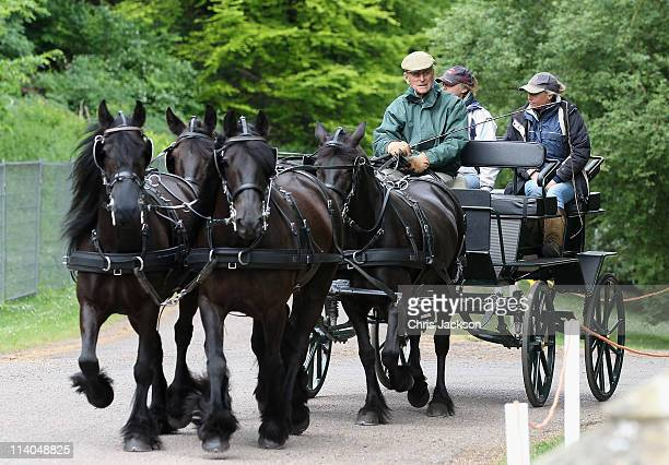 Prince Philip Duke of Edinburgh rides through the grounds of Windsor Castle during Windsor Horse Show on May 11 2011 in Windsor England
