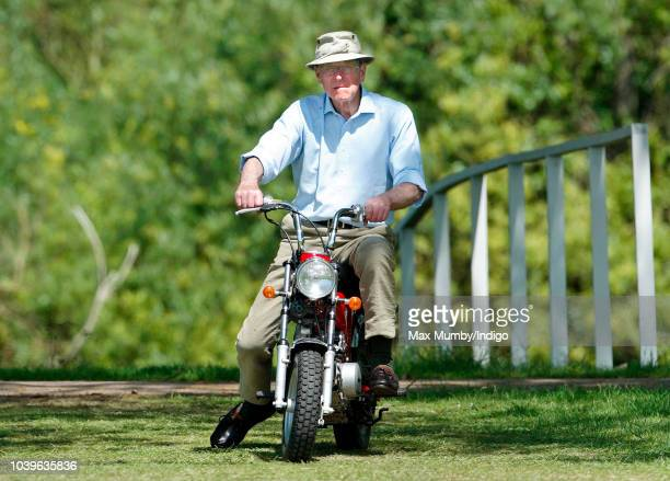 Prince Philip Duke of Edinburgh seen riding a mini 'EasyRider' motorbike as he attends the Royal Windsor Horse Show in Home Park on May 16 2002 in...