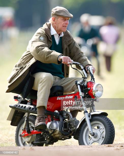 Prince Philip, Duke of Edinburgh seen riding a mini 'Easy-Rider' motorbike as he attends the Royal Windsor Horse Show in Home Park on May 13, 2005 in...