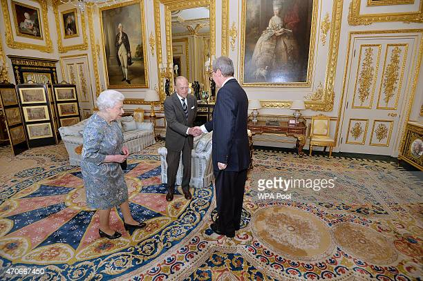 Prince Philip, Duke of Edinburgh shakes hands with the Australian High Commissioner Alexander Downer prior to the Duke being presented by Queen...