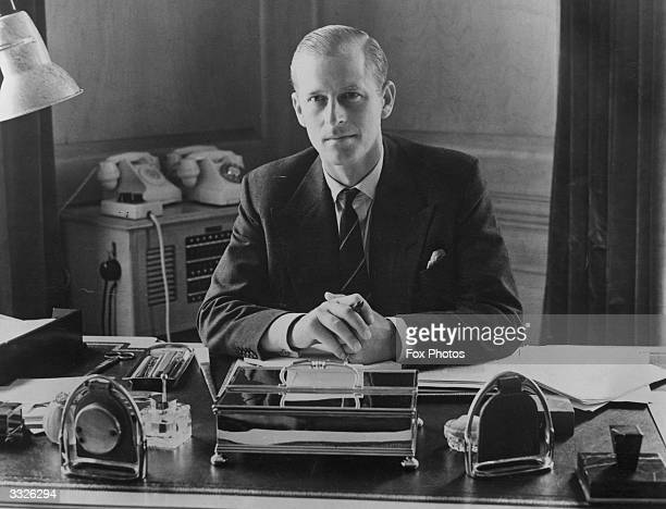 Prince Philip, Duke of Edinburgh, sitting at his desk at Clarence House, 10th August 1951.