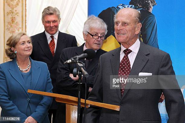 Prince Philip Duke of Edinburgh speaks beside Frances Fitzgerald Minister for Children and Youth Affairs and Dr Lawrence Crowley Chairman of Gaisce...