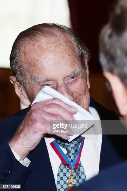 Prince Philip Duke of Edinburgh speaks to guests after attending the Order of Merit service at Chapel Royal at St James's Palace on May 4 2017 in...