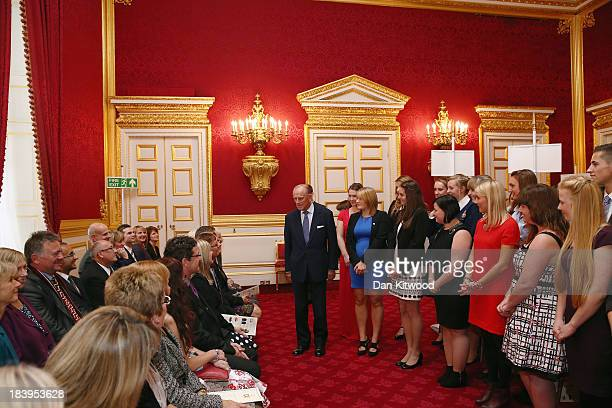 Prince Philip Duke of Edinburgh speaks to the parents of groups of young people during a reception to celebrate the 500th anniversary of his 'Duke of...