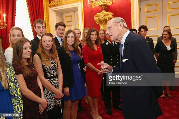 Prince Philip Duke of Edinburgh speaks with a group of young people during a reception to celebrate the 500th anniversary of his 'Duke of Edinburgh...