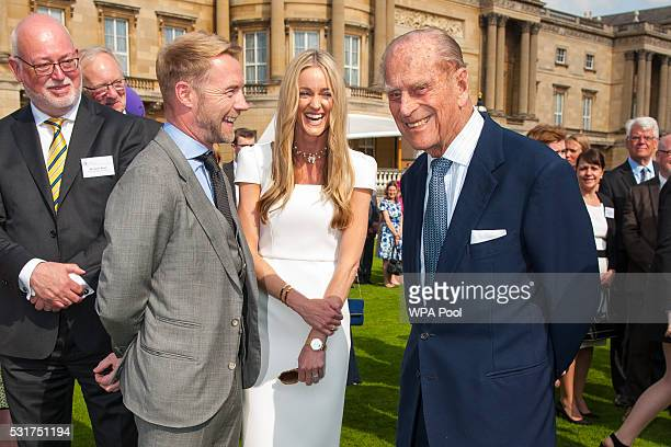 Prince Philip Duke of Edinburgh speaks with Ronan Keating and his wife Storm during the Duke of Edinburgh Award's 60th Anniversary Garden Party at...