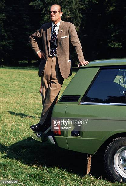 Prince Philip Duke of Edinburgh standing on his Range Rover car at the Royal Windsor Horse Show