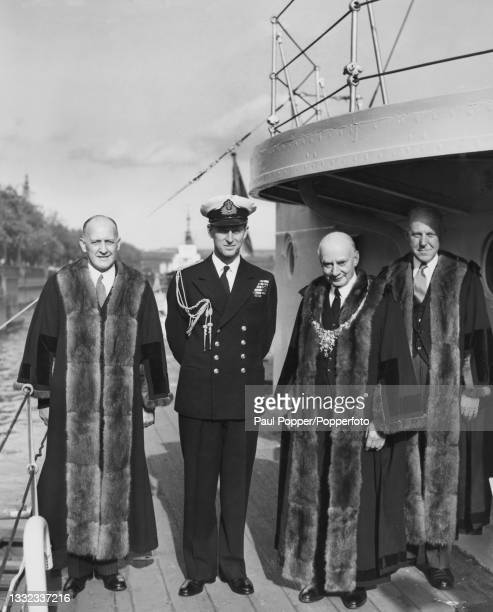Prince Philip, Duke of Edinburgh stands 2nd from left with senior officials of the Honourable Company of Master Mariners aboard the headquarters...